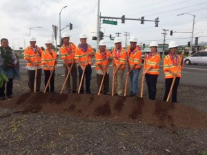 A groundbreaking ceremony was held to celebrate the start of the Queen Kaahumanu Highway Widening, Phase 2 project. From left to right: Kahu Daniel 'Kaniela' Akaka Jr.; Ed Sniffen, HDOT Deputy Director of Highways; Cindy Evans, State House of Representatives; Dru Mamo Kanuha, Hawaii County Council Chair; Chad Goodfellow, Goodfellow Bros., Inc. President; Ford Fuchigami, HDOT Director; Steve Goodfellow, Goodfellow Bros., Inc. CEO; Ed Brown, Goodfellow Bros. Inc. Director of Operations; Nicole Lowen, State House of Representatives; Mayela Sosa, Federal Highways Administration Division Administrator.