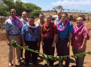 Governor David Ige and state officials untie the maile lei to bless the new Maui Conrac facility, a component of the statewide Modernization Program. From left to right: Representative Justin Woodson; Marvin Moniz, Kahului Airport Manager; Mayor Alan Arakawa; Ross Higashi, HDOT Airports Division Deputy Director; Governor David Ige; Gerry Majkut, President of Hawaiian Dredging Construction Company; Senator Kalani English; Senator Gilbert Keith-Agaran.