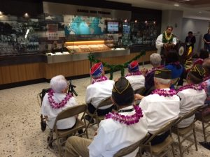 The distinguished veterans watch as the new Hawaii Nisei Veterans exhibit at the Honolulu International Airport is blessed by Kahu Wendell Davis.