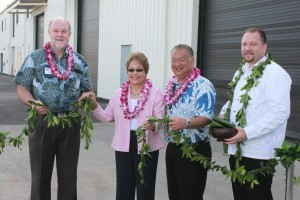 Brian Taylor, UH SOEST Dean; Senator Lorraine Inouye; Darrell Young, HDOT Harbors Division Deputy Director; Kahu Hailama Farden perform the ceremonial untying of the maile lei at the new facility at Pier 35.