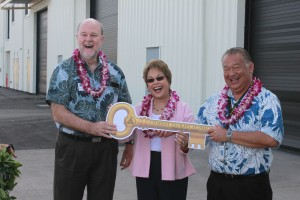 Darrell Young, HDOT Harbors Division Deputy Director (right) and Senator Lorraine Inouye hand over the ceremonial key for the new facility to Brian Taylor, UH SOEST Dean.