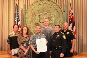 Governor David Ige issued a proclamation to initiate the Click It or Ticket campaign.  From left to right: Ford Fuchigami, HDOT Director; Kari Benes, DOH Trauma System Public Health Educator; Governor David Ige; Greg Fredericksen, NHTSA Region 9 Deputy Administrator; Major Darren Izumo, Honolulu Police Department; Lieutenant William Gannon, Maui Police Department