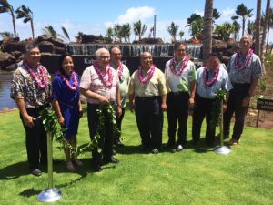 State officials and dignitaries untie the maile lei for the Kahului Airport Access Road blessing ceremony. From left to right: Ross Higashi, Deputy Director, HDOT Airports Division; Leah Belmonte, Governor Ige's Maui Representative; Joseph Souki, House of Representatives; Marvin Moniz, Maui Airports District Manager; Gilbert Keith-Agaran, State Senator; Kalani English, State Senator; Alan Arakawa, Maui County Mayor; Gerry Majkut, Hawaiian Dredging Construction Company.