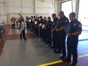 Kahu Kealoha blesses the airport firefighters during the dedication ceremony.