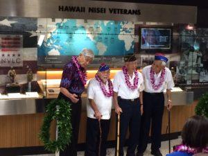 Honored veterans from left to right: Governor George Ariyoshi, Kenji Ego, Herbert Yanamura, and Robert Kishinami.